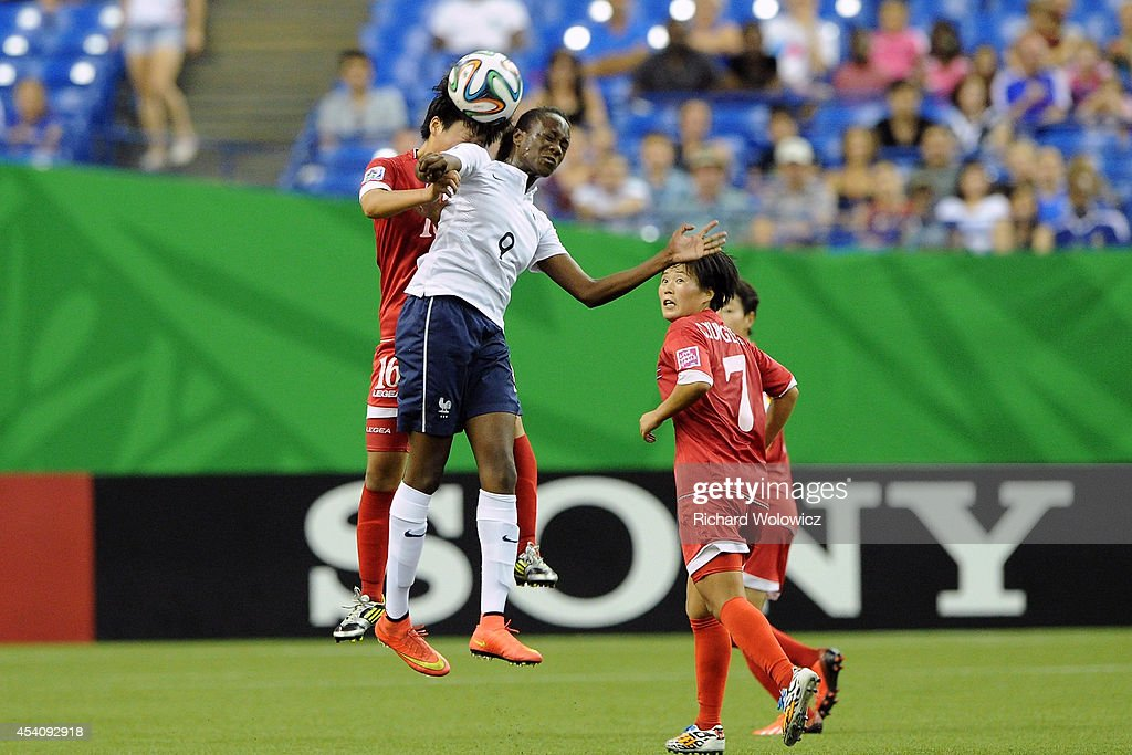 Ouleymata Sarr of France jumps to head the ball in front of Ri Un Yong of Korea DPR during the FIFA Women's U-20 3rd place game at Olympic Stadium on August 24, 2014 in Montreal, Quebec, Canada. France defeated Korea DPR