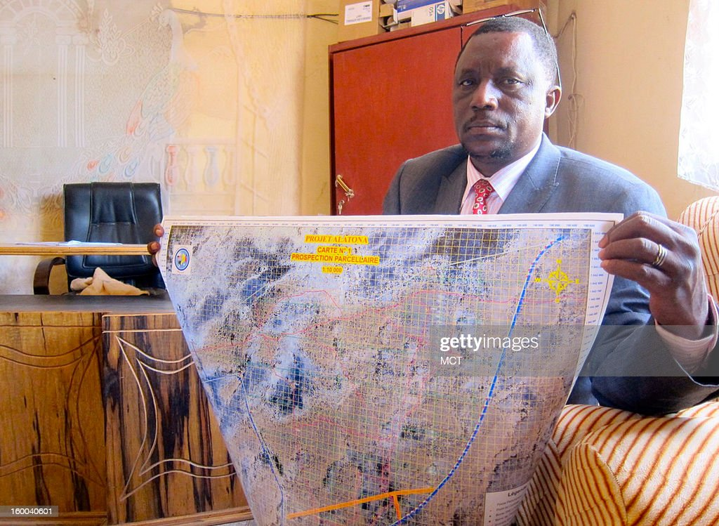 Oumar Diakite, mayor of Diabably, Mali, shows one of the maps he used to relay ground coordinates to the French military on Islamist rebels who captured the town on Jan. 14. The maps were originally produced during U.S.-funded aid projects in the community.