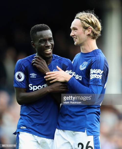 Oumar Niasse and Tom Davies of Everton celebrate their 21 victory in the Premier League match between Everton and AFC Bournemouth at Goodison Park on...