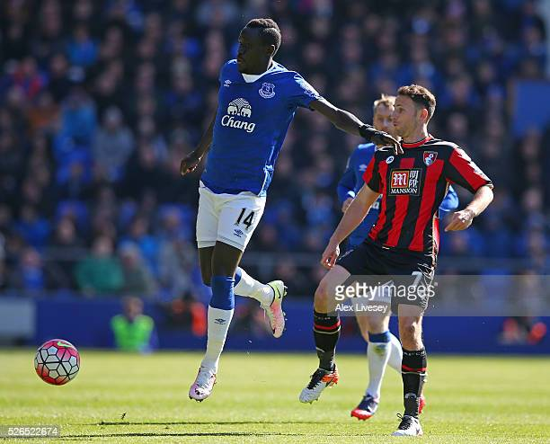 Oumar Niasse of Everton and Marc Pugh of Bournemouth compete for the ball during the Barclays Premier League match between Everton and AFC...