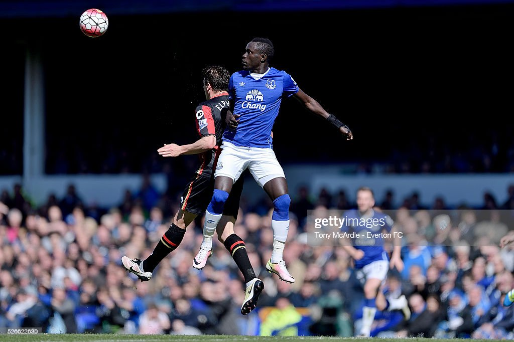 Oumar Niasse of Everton and Tommy Elphick in an aerial challenge during the Barclays Premier League match between Everton and A.F.C. Bournemouth at Goodison Park on April 30, 2016 in Liverpool, England.