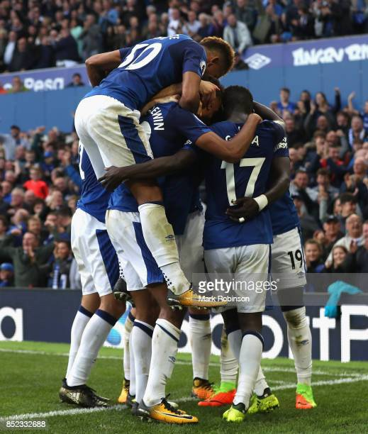 Oumar Niasse of Everton celebrates scoring his side's second goal with his team mates during the Premier League match between Everton and AFC...