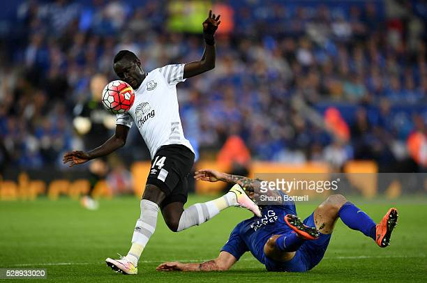 Oumar Niasse of Everton runs with the ball past Marcin Wasilewski of Leicester City during the Barclays Premier League match between Leicester City...
