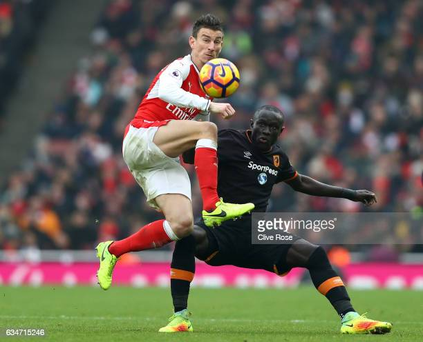 Oumar Niasse of Hull City and Laurent Koscielny of Arsenal compete for the ball during the Premier League match between Arsenal and Hull City at...