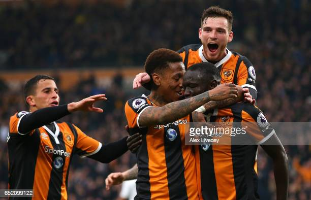 Oumar Niasse of Hull City celebrates scoring his sides first goal with his Hull City team mates during the Premier League match between Hull City and...