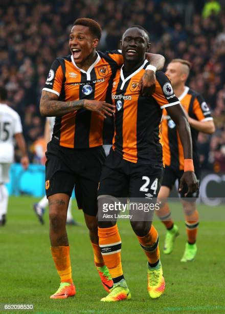 Oumar Niasse of Hull City celebrates with Abel Hernandez as he scores their first goal during the Premier League match between Hull City and Swansea...