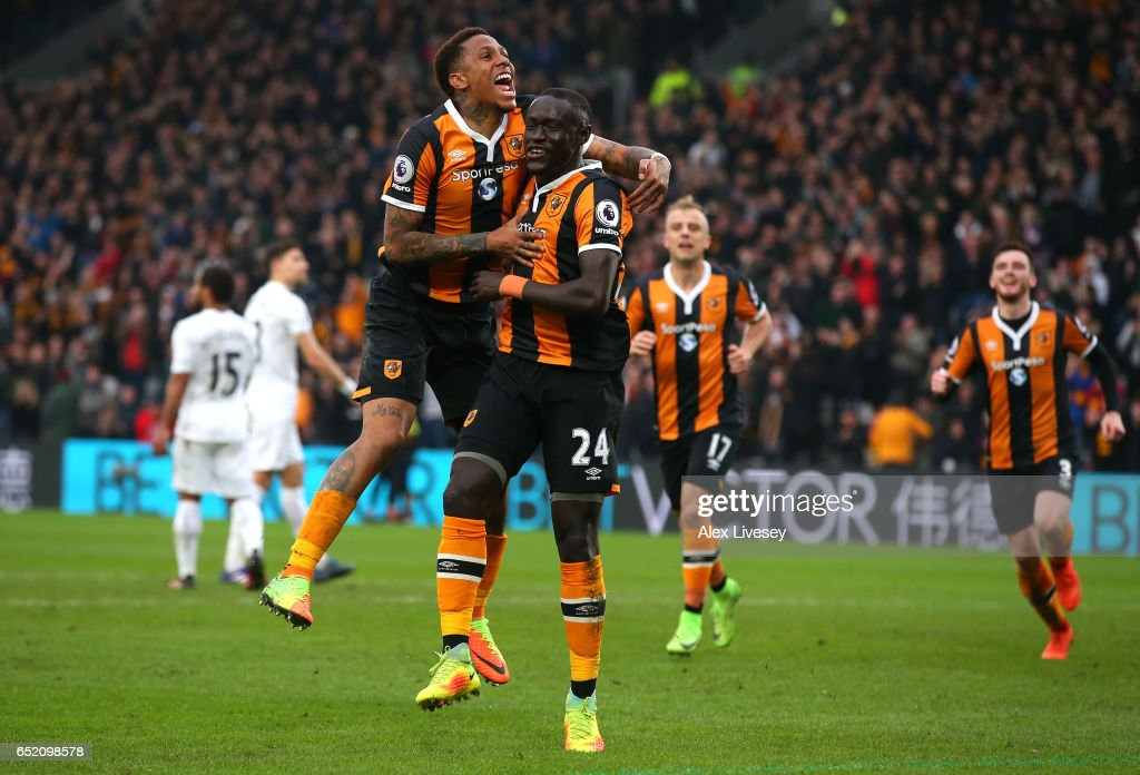 Oumar Niasse of Hull City (24) celebrates with Abel Hernandez as he scores their first goal during the Premier League match between Hull City and Swansea City at KCOM Stadium on March 11, 2017 in Hull, England.
