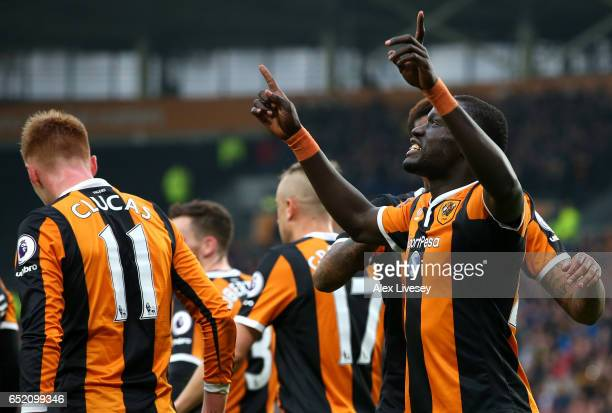 Oumar Niasse of Hull City celebrates with team mates as he scores their first goal during the Premier League match between Hull City and Swansea City...