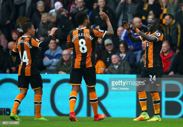 Oumar Niasse of Hull City celebrates with team mates as he scores their second goal during the Premier League match between Hull City and Swansea...