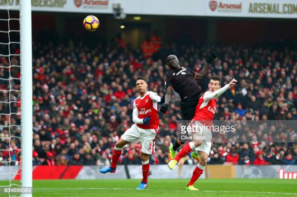 Oumar Niasse of Hull City heads the ball during the Premier League match between Arsenal and Hull City at Emirates Stadium on February 11 2017 in...