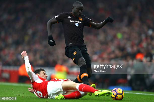 Oumar Niasse of Hull City is tackled by Laurent Koscielny of Arsenal during the Premier League match between Arsenal and Hull City at Emirates...