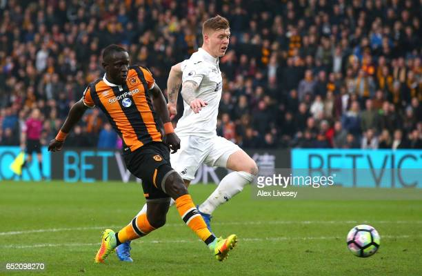 Oumar Niasse of Hull City scores their first goal during the Premier League match between Hull City and Swansea City at KCOM Stadium on March 11 2017...
