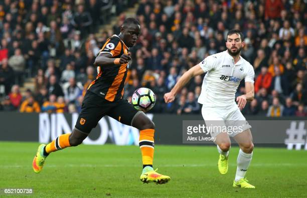 Oumar Niasse of Hull City scores their second goal during the Premier League match between Hull City and Swansea City at KCOM Stadium on March 11...