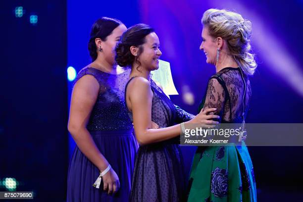 'Our Earth' award winners Isabel and Melati Wijsen congratulated by Maria Furtwaengler during the Bambi Awards 2017 show at Stage Theater on November...
