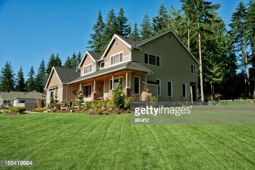 Our home with fresh cut lush green grass