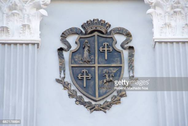 Our Lady of Assumption Catholic cathedral church in the traditional Santiago de Cuba Coat of Arms of the city decorating walls The temple is a...