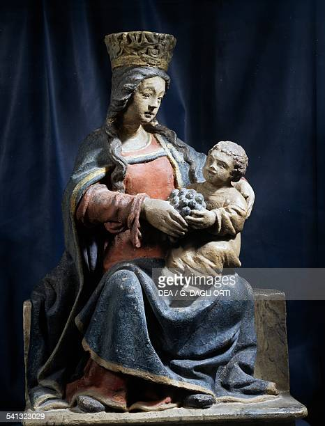 Our Lady of Beaune Madonna and child with grapes in his hands polychrome stone statue height 52 cm France 16th century Beaune Musée Du Vin De...
