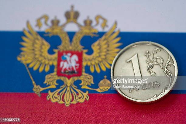 Our picture shows a Russian 1 Ruble coin on the Russian flag with the state coat of arms on December 31 2014 in Bonn Germany