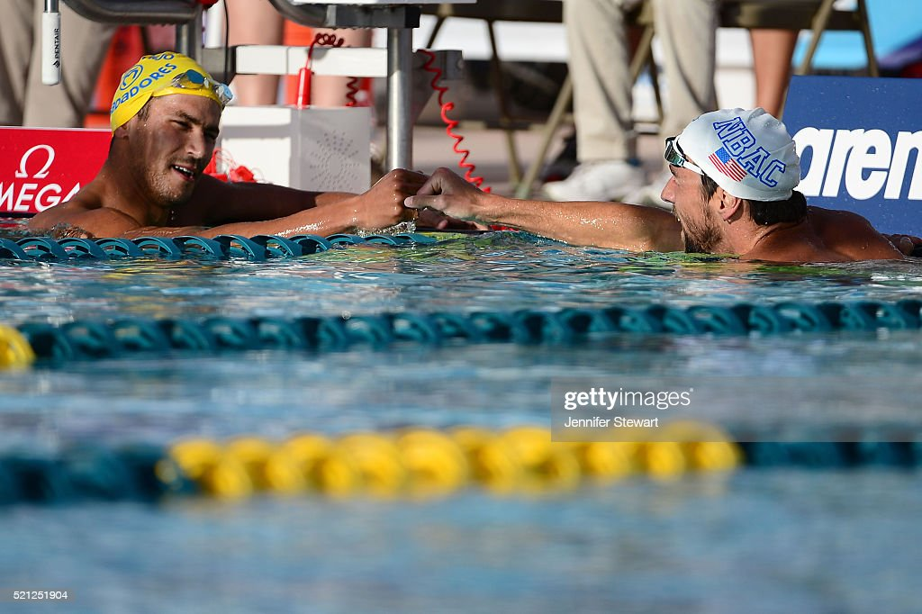 Ous Mellouli (L) congratulates <a gi-track='captionPersonalityLinkClicked' href=/galleries/search?phrase=Michael+Phelps&family=editorial&specificpeople=162698 ng-click='$event.stopPropagation()'>Michael Phelps</a> (R) after Phelps won the Men 200 LC Meter Freestyle B-final at Skyline Aquatic Center on April 14, 2016 in Mesa, Arizona.