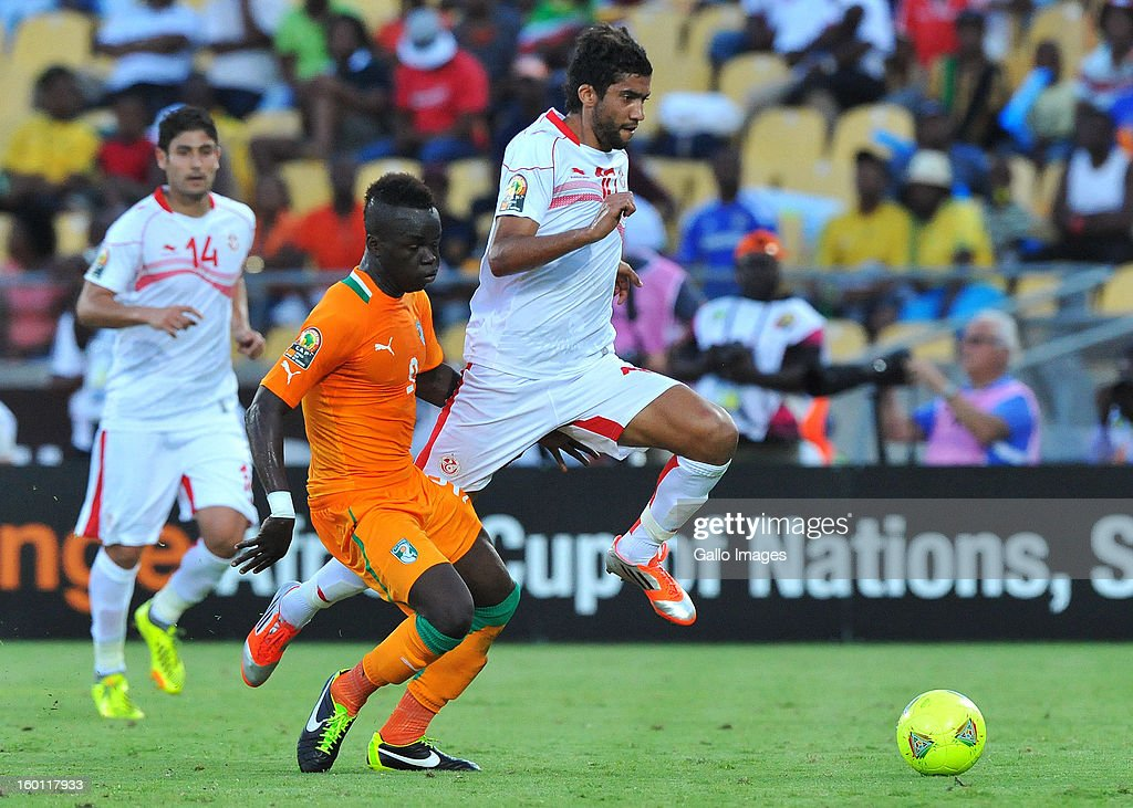 AFRICA - JANUARY 26, Ousama Darragi of Tunisia attacks during the 2013 African Cup of Nations match between Ivory Coast and Tunisia at Royal Bafokeng Stadium on January 26, 2013 in Rustenburg, South Africa.