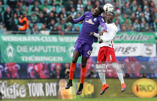 Ousman Manneh of Bremen and Naby Deco Keita of Leipzig jump for a header during the Bundesliga match between RB Leipzig and SV Werder Bremen at Red...