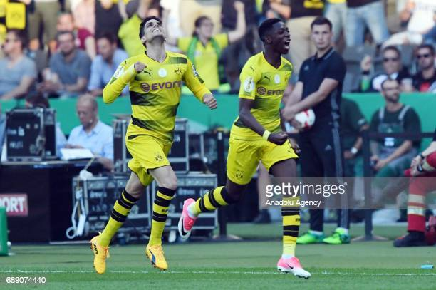 Ousmane Dembele and Marc Bartra of Borussia Dortmund celebrate after scoring a goal during the DFB Cup Final 2017 soccer match between Eintracht...