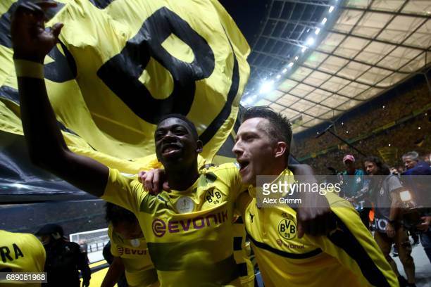 Ousmane Dembele and Marco Reus of Dortmund celebrate after winning the DFB Cup final match between Eintracht Frankfurt and Borussia Dortmund at...