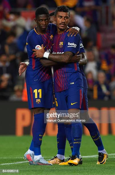 Ousmane Dembele and Paulinho of Barcelona ceebrate after the La Liga match between Barcelona and Espanyol at Camp Nou on September 9 2017 in...