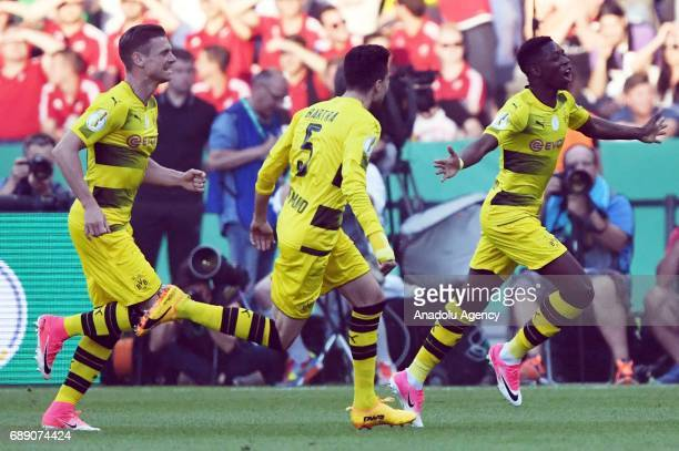 Ousmane Dembele Marc Bartra and Lukasz Piszczek of Borussia Dortmund celebrate after scoring a goal during the DFB Cup Final 2017 soccer match...