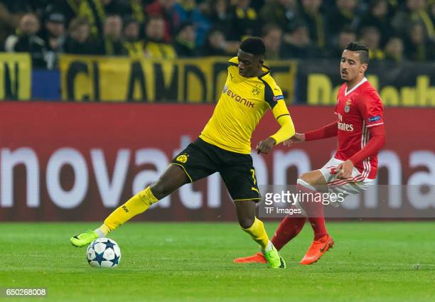 Ousmane Dembele of Borussia Dortmund and Andre Almeida of Benfica battle for the ball during the UEFA Champions League Round of 16 Second Leg match...