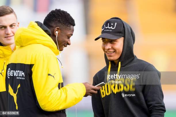 Ousmane Dembele of Borussia Dortmund and Emre Mor of Borussia Dortmund looks on during the Bundesliga match between SV Darmstadt 98 and Borussia...
