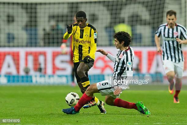 Ousmane Dembele of Borussia Dortmund and Jesus Vallejo of Eintracht Frankfurt battle for the ball during the Bundesliga match between Eintracht...