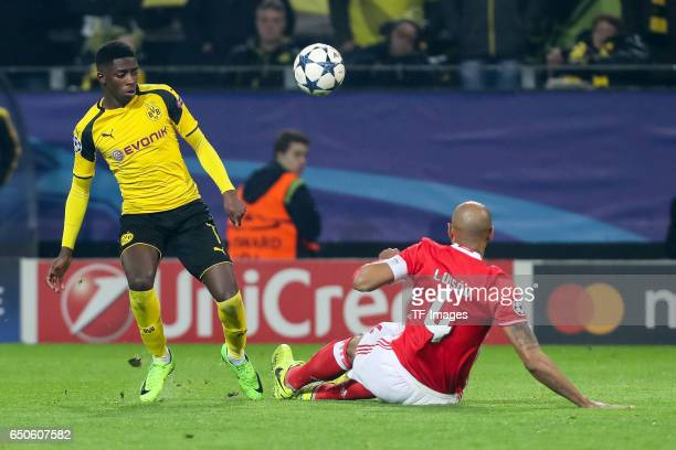 Ousmane Dembele of Borussia Dortmund and Luisao of Benfica battle for the ball during the UEFA Champions League Round of 16 Second Leg match between...