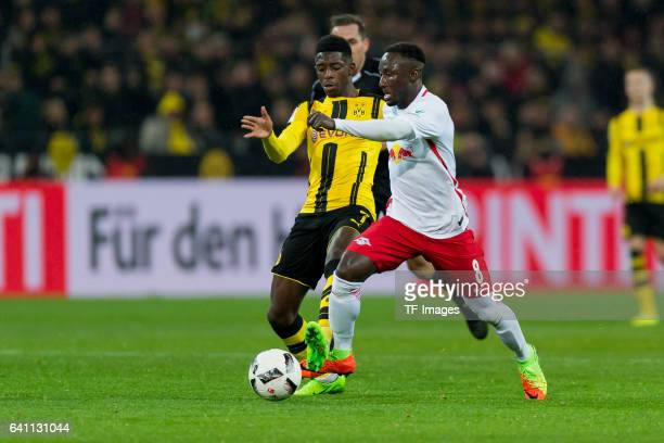 Ousmane Dembele of Borussia Dortmund and Naby Keita of RB Leipzig battle for the ball during the Bundesliga soccer match between Borussia Dortmund...