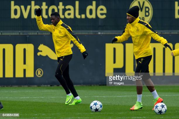 Ousmane Dembele of Borussia Dortmund and PierreEmerick Aubameyang of Borussia Dortmund prepares prior the training of Borussia Dortmund ahead of the...
