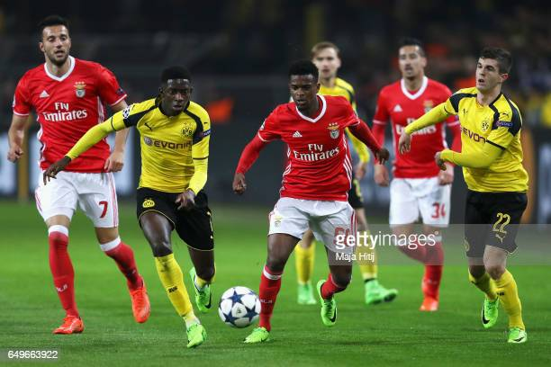 Ousmane Dembele of Borussia Dortmund battles for the ball with Nelson Semedo of SL Benfica during the UEFA Champions League Round of 16 second leg...