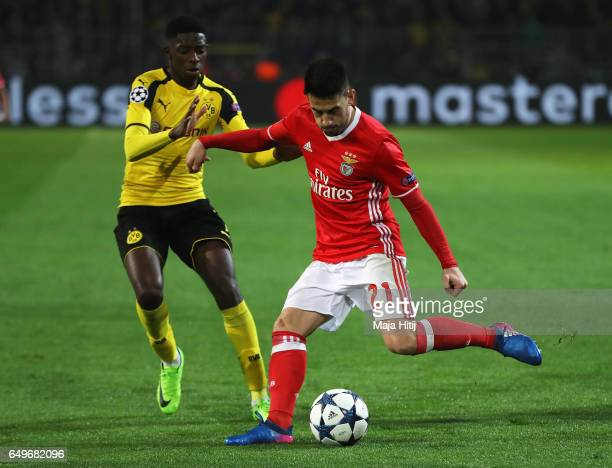 Ousmane Dembele of Borussia Dortmund battles for the ball with Pizzi of SL Benfica during the UEFA Champions League Round of 16 second leg match...