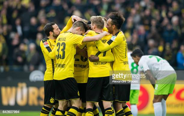 Ousmane Dembele of Borussia Dortmund celebrates after scoring the goal to the 30 together with his team mates during the Bundesliga match between...