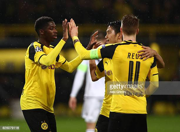 Ousmane Dembele of Borussia Dortmund celebrates scoring his teams fourth goal with teammates Shinji Kagawa and Marco Reus during the UEFA Champions...