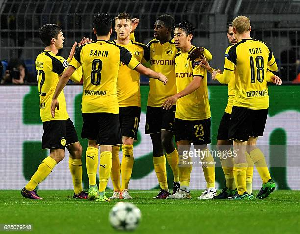 Ousmane Dembele of Borussia Dortmund celebrates scoring his teams fourth goal with teammates during the UEFA Champions League Group F match between...
