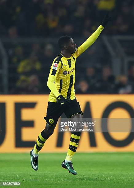 Ousmane Dembele of Borussia Dortmund celebrates scoring his team's opening goal during the Bundesliga match between Borussia Dortmund and FC Augsburg...