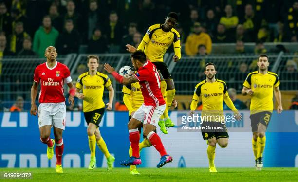 Ousmane Dembele of Borussia Dortmund challenges Eduardo Silvio of SL Benfica during the UEFA Champions League Round of 16 Second Leg match between...