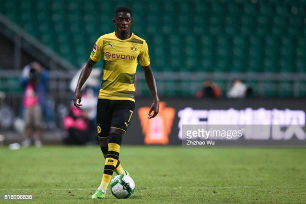 Ousmane Dembele of Borussia Dortmund controls the ball at University Town during the 2017 International Champions Cup football match between AC milan...