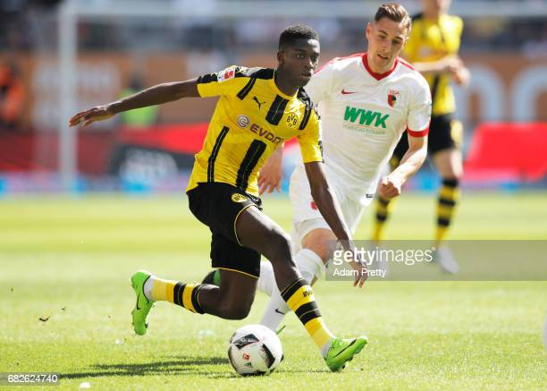 Ousmane Dembele of Borussia Dortmund is challenged by Dominik Kohr of Augsburg during the Bundesliga match between FC Augsburg and Borussia Dortmund...