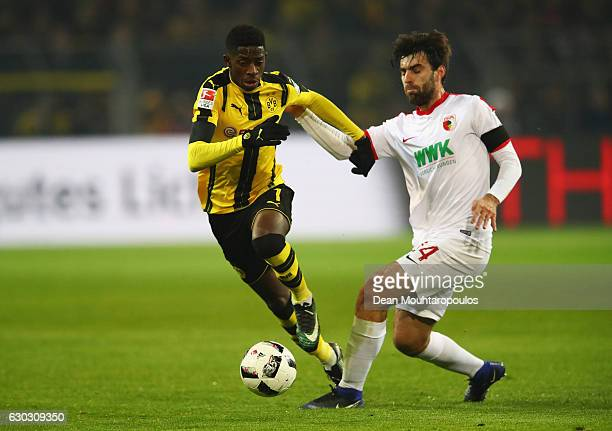 Ousmane Dembele of Borussia Dortmund is tackled by Jan Moravek of FC Augsburg during the Bundesliga match between Borussia Dortmund and FC Augsburg...