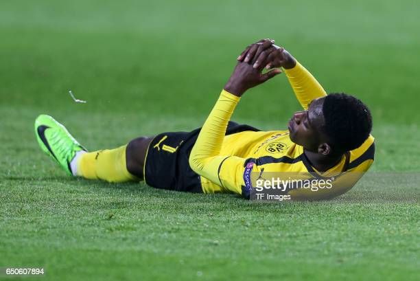 Ousmane Dembele of Borussia Dortmund on the ground during the UEFA Champions League Round of 16 Second Leg match between Borussia Dortmund and SL...