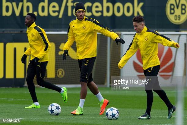 Ousmane Dembele of Borussia Dortmund PierreEmerick Aubameyang of Borussia Dortmund and Emre Mor of Borussia Dortmund prepares prior the training of...