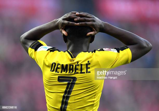 Ousmane Dembele of Borussia Dortmund reacts during the Bundesliga match between Bayern Muenchen and Borussia Dortmund at Allianz Arena on April 8...