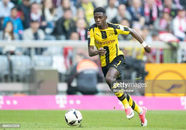 Ousmane Dembele of Borussia Dortmund runs with the ball during the Bundesliga match between Bayern Muenchen and Borussia Dortmund at Allianz Arena on...