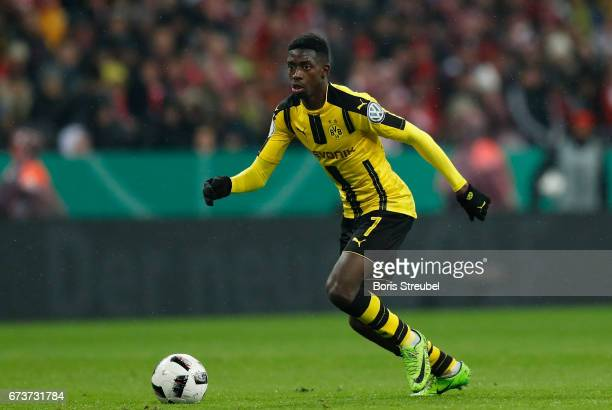 Ousmane Dembele of Borussia Dortmund runs with the ball during the DFB Cup semi final match between FC Bayern Muenchen and Borussia Dortmund at...